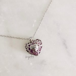 Sterling silver heart locket with heart keepsake inside. Inclussions: ashes and clear quartz