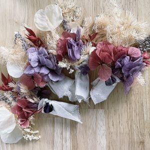 A collection of June Healing Bouquets, featuring dried flowers and an amethyst stone